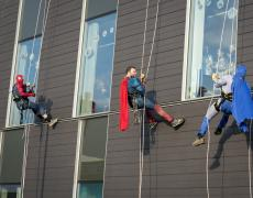 Superheroes abseiling at Royal Manchester Children's Hospital