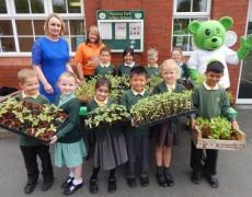 Pupils handing over the plants